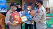 Polsek Bukit Bestari Bersama KSK Bagikan Sembako Kepada Masyarakat Terdampak Covid-19